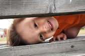 Boy playfull hiding — Stock Photo