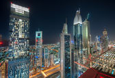 Dubai Skyscraper at Night. Taken at a Roof top of Sheik Zayed Road, Dubai at Blue Hour — Stock Photo
