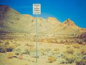 Retro look Rhyolite in Death Valley Nevada USA — Stock Photo