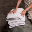Stacked white spa towels — Stock Photo #49114493