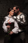 Knight giving a rose to lady — Stock Photo