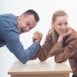 Workmates playing arm wrestling — Stock Photo #49375579