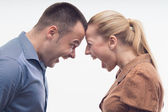 Colleagues fighting each other with foreheads together — Stock Photo