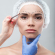 Beautiful young woman in surgical cap with perforation lines on — Stock Photo #50084811