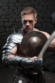 Gladiator with shield and sword — Stock Photo