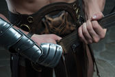 Closeup of gladiator holding sword — Stock Photo
