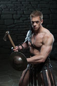 Gladiator with shield and axe — Stock Photo