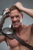 Gladiator despair on grey background — Stock Photo