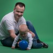 Father and toddler son playing with ball — Stock Photo #50723425