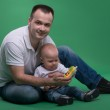 Father and toddler son playing with toy cell phone — Stock Photo #50723461