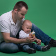 Father and toddler son playing with toy cell phone — Stock Photo #50723463
