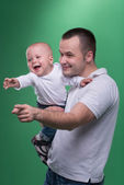 Happy smiling father embracing his baby boy — Stock Photo