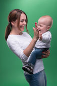Young mother and her toddler son pointing at something — Stock Photo