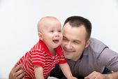 Father embracing his cute toddler son — Stock Photo