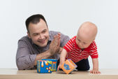 Father playing with his toddler son — Stock Photo