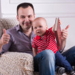 Father and toddler son reading a book — Stock Photo #50850107
