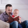 Father and toddler son  reading a book — Stock Photo #50850123