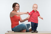 Mother catching active little kid — Stockfoto