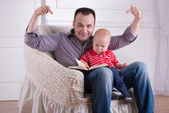 Father and toddler son reading a book — Stock Photo