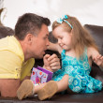 Cute little girl having fun with presents — Stock Photo #50937819