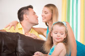 Cute little girl having fun with parents — Stock Photo