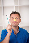 Handsome father with paintbrush — Stock Photo