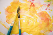 Paints and paintbrushes — Stock Photo