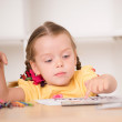 Cute little girl painting — Stock Photo #50976373