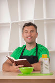 Funny man in apron cooking — Stock Photo
