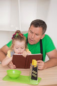 Family concept, cute little girl with father preparing to cook — Stock Photo