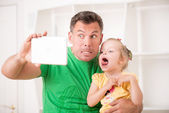 Father and child using electronic tablet at home — Foto Stock