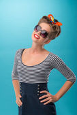 Beautiful girl with pretty smile in pinup style posing — Stock Photo