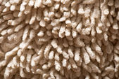 Close-up view of carpet  texture used as background — Stock Photo