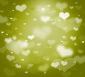 Hearts on green background — Stock Photo