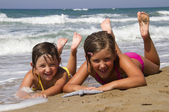 Happy girls on the beach — Stock Photo