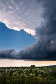 Lightning storm over a summer field  — Stock Photo