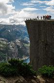 Tourists on Preikestolen cliff in Norway, Lysefjord view — Stock Photo