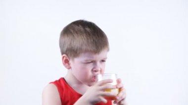 Boy drinking juice — Stock Video
