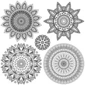 Set of vector flower ornaments — Stock Vector