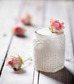 Rose flavor Greek yogurt in a glass jarwith lace — Stock Photo