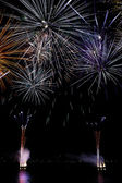 Nocturnal celebration with colorful fireworks — Stock Photo