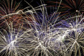 Fireworks exploding at night — Stock Photo