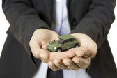 Hands presenting a toy car — Stockfoto
