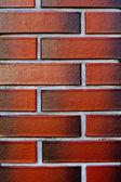 Fondo rojo con textura de la pared de ladrillo nuevo y limpio — Foto de Stock