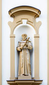 Christian sculpture at the facade of the Church — Stock Photo