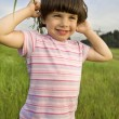 Little cute pensive girl five years old standing on  park  — Stock Photo #45375207