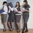 Four businesswoman standing in line — Stock Photo #45378111
