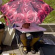 Girl under sun umbrella draw some picture — Stock Photo #45379987