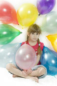 Young happy girl with colour balloons — Stock Photo