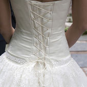 Detail from the wedding dress — Stock Photo